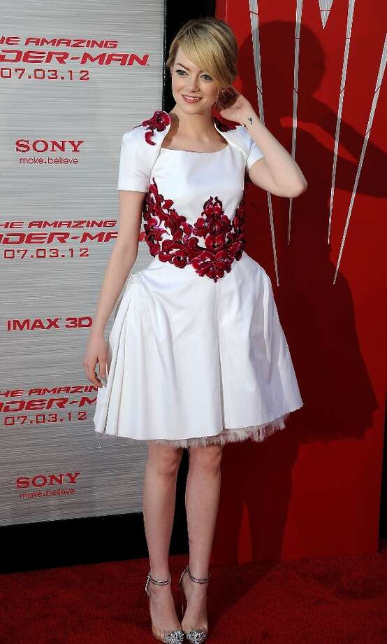 """Vogue's best dressed woman of 2012: Emma Stone, shown here at the premiere of her film """"The Amazing  Spiderman."""" Photo: AFP, AFP/Getty Images / 2012 AFP"""