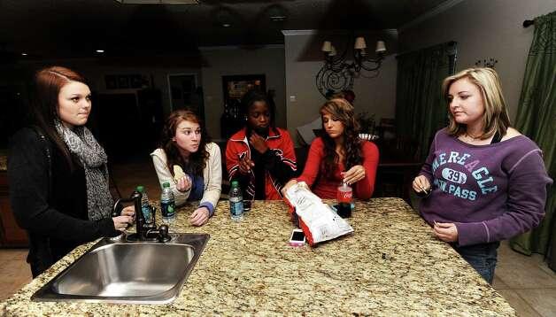 From left to right; Savannah Short, 14, Ashton Lawrence, 16, Kieara Moffett, 16, Macy Matthews, 15, and Rebekah Richardson, 17, chat at the Richardson household on Wednesday, November, 13, 2012.  The Kountze cheerleaders hav