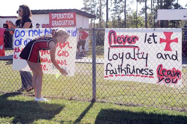 After a judge granted a temporary restraining order in the Kountze cheerleader case, the cheerleaders of Kountze Middle School used their faith-based  signs at the middle school football game held at Kountze High School on Thursday, September 20, 2012. Photo taken: Randy Edwards/The Enterprise Photo: Randy Edwards