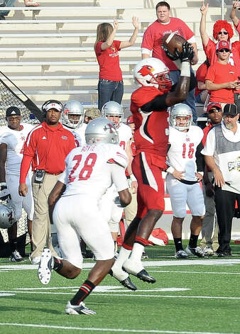 Lamar wide receiver Barry Ford, 3, makes a great catch for gain another first down during the Lamar University game against Nicholls State at the Provost Umphrey Stadium on Saturday, November 10, 2012. Photo taken: Randy Edwards/The Enterprise