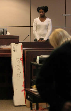 Tracy Devon Brown took the witness stand in a second trial for sentencing for shooting her ex-husband in 2009 in the 144th District Court with Judge Angus McGinty on Thursday, Nov. 15, 2012. Brown's first jury could not come to a decision on sentencing and now a second jury is hearing the case to determine a sentence. Brown's attorney told a separate jury in 2010 that she committed the killing because of mental illness caused by domestic violence. Photo: Kin Man Hui, San Antonio Express-News / ©2012 San Antonio Express-News