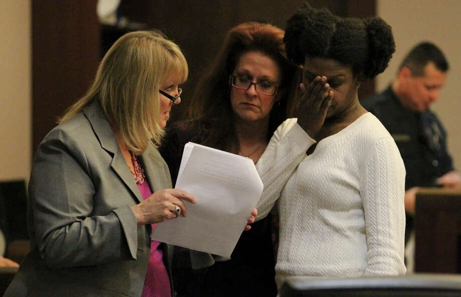 Tracy Devon Brown (right) meets with her attorneys Sharon Thorn (from left) and Suzanne Kramer after a break from the witness stand on Thursday, Nov. 15, 2012. Brown was convicted of murder for shooting her ex-husband in 2009. Brown's first jury could not come to a decision on sentencing and now a second jury is hearing the case to determine a sentence. Brown's attorney told a separate jury in 2010 that she committed the killing because of mental illness caused by domestic violence. A new trial took place in the 144th District Court with Judge Angus McGinty on Thursday, Nov. 15, 2012. Photo: Kin Man Hui, San Antonio Express-News / ©2012 San Antonio Express-News