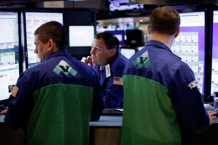 FILE - In this Thursday, Nov. 15, 2012, file photo, traders work on the floor at the New York Stock Exchange. Trading on world stock markets was lethargic Friday Nov. 16, 2012 after data showed Europe slipped back into recession and several big U.S. retailers disappointed investors with weak forecasts.(AP Photo/Seth Wenig) Photo: Seth Wenig
