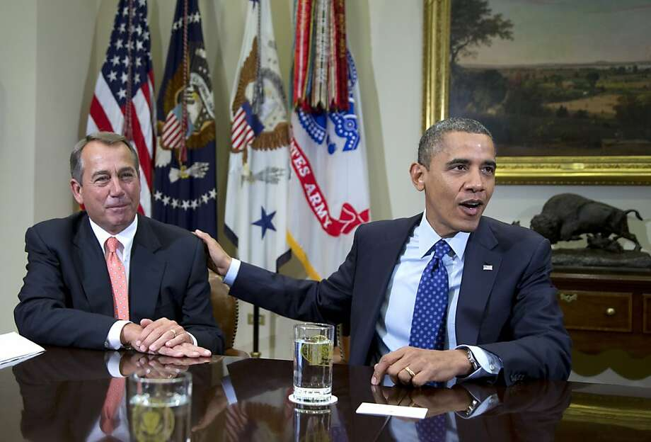 President Obama gives House Speaker John Boehner a friendly pat at the White House at the start of negotiations on debt reduction and tax increases Photo: Carolyn Kaster, Associated Press