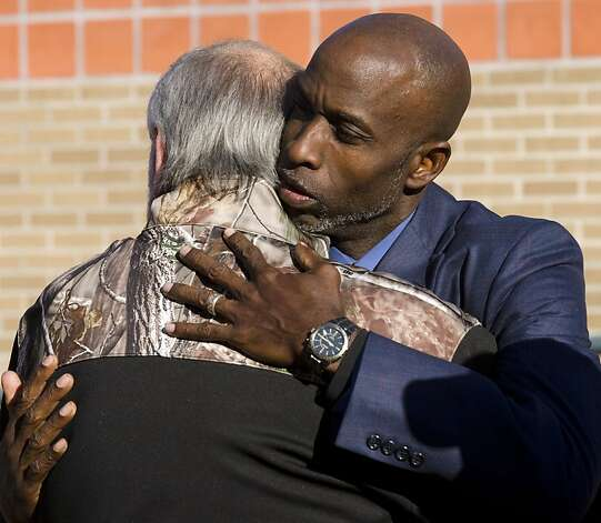 Pastor Roy Smith comforts Terry Johnson, Friday, Nov. 16, 2012, in Midland, Texas, following a community prayer service for all those involved in an incident Thursday, where four veterans were killed and 16 other people were injured when a train slammed into a parade float carrying the returning heroes to a banquet. (AP Photo/Reporter-Telegram, Tim Fischer) Photo: Tim Fischer, Associated Press