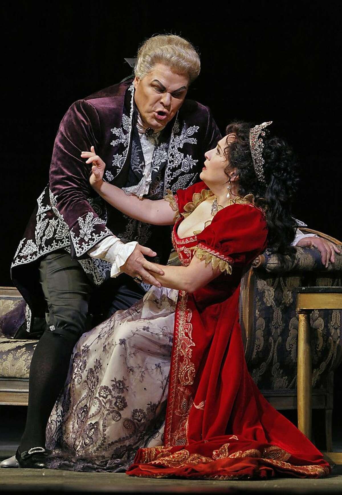 """Baritone Mark Delavan (l.) as Scarpia and soprano Patricia Racette (l.) as Tosca in Puccini's """"Tosca"""" at SF Opera"""