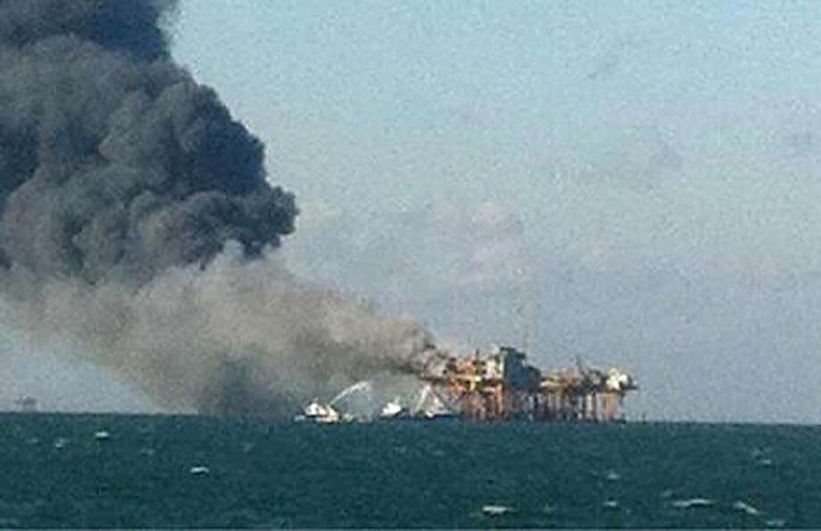 A fire burns on a Gulf of Mexico oil platform, in an image released by an oil field worker. Photo: Associated Press