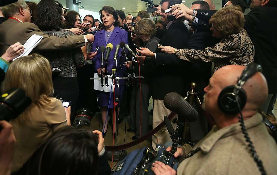 Senate intelligence committee chair Dianne Feinstein talks to the media after a hearing on the Benghazi attack. Photo: Alex Wong, Getty Images