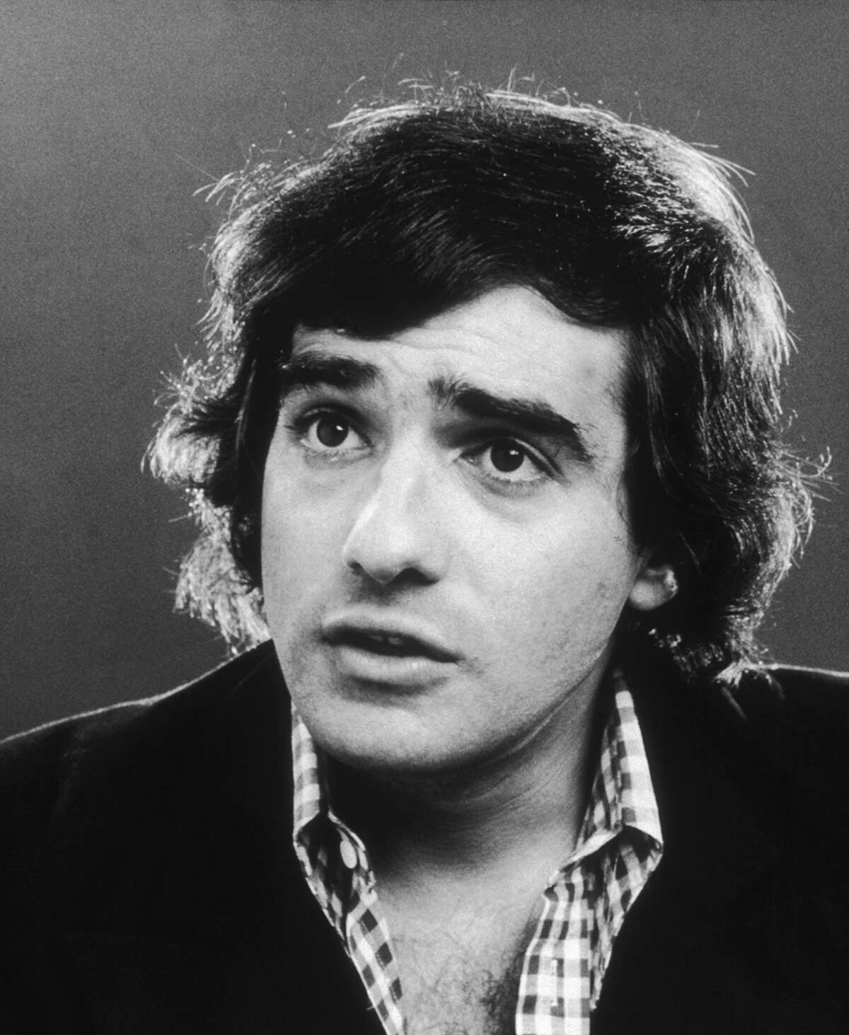 Born in New York City, Martin Scorsese once wanted to be a priest and had even entered a seminary. But he changed his mind and went to film school instead. He's pictured in 1973.