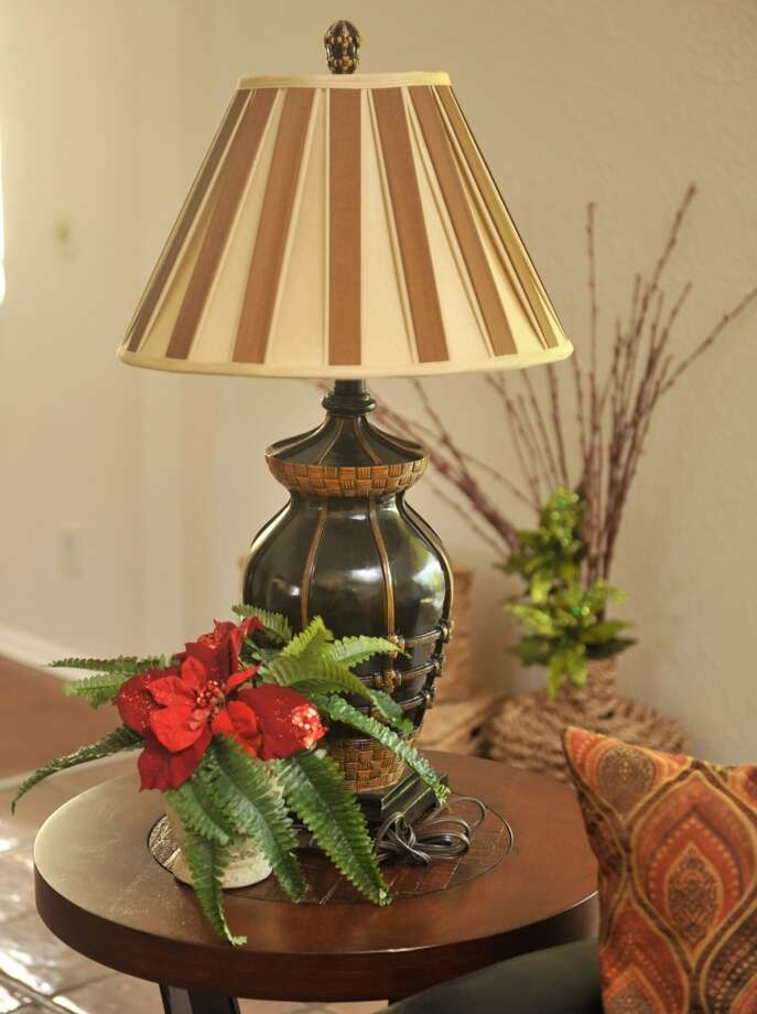 Poinsetta's are used throughout staging a home for sale during the holidays. (Robin Jerstad/For the Express-Ne)