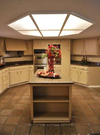 The red holiday decorations are used in staging a kitchen to draw the buuyer's eye's to that area. (Robin Jerstad/For the Express-Ne)