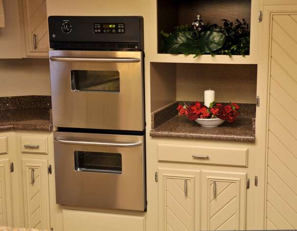 A minimal amount of holiday decorating is used when staging a kitchen during the Chrstmas season. (Robin Jerstad/For the Express-Ne)