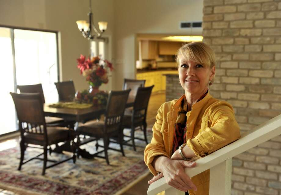 Kathleen Murray of Staging Spaces SA uses recommends using poinsetta's to stage a home to be sold during the holiday's. (Robin Jerstad/For the Express-Ne)