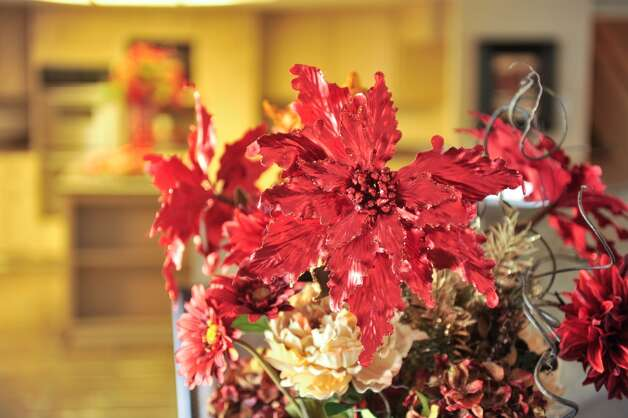 Poinsetta's are used throughout staging a home for sale during the holidays. (For the Express-News)