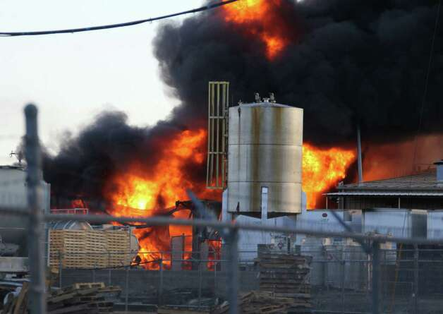 Firefighters allow a chemical fire to burn off at the Nexeo Solutions plant in Garland, Texas, on Friday, Nov. 16, 2012. Fire Capt. Merrill Balanciere says it's still unclear what caused the fire, but the flames were fueled by highly flammable toluene and methanol. All 41 workers who were at the plant at the time of the fire are safe. Photo: Louis DeLuca, Associated Press / The Dallas Morning News