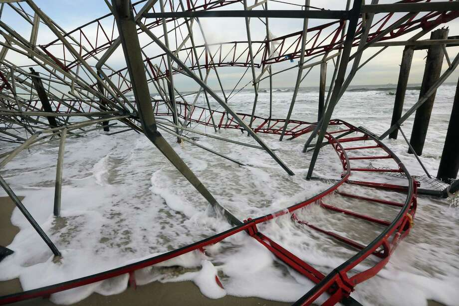 Waves break at a destroyed roller coaster from the Funtown Pier on November 16, 2012 in Seaside Heights, New Jersey. Two amusement piers and a number of roller coasters in the seaside town were destroyed by Superstorm Sandy. Photo: Mario Tama, Getty Images / 2012 Getty Images