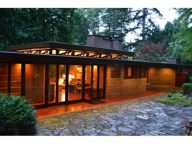 "Brandes Residence: Frank Lloyd Wright designed this Sammamish home in his ""Usonian"" style, which aimed for middle-class affordability, employing such elements as low roofs, carports, an open floor plan, masonry walls and clerestory windows. Photo: Courtesy Realogics Sotheby's International Realty"