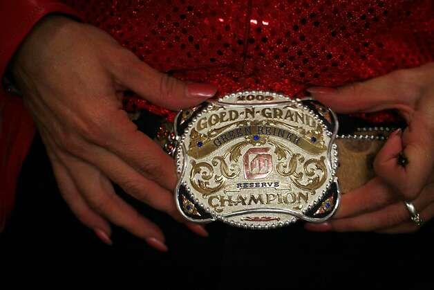 Laura Vaughn shows off the spoils of past drill team events. Photo: Mike Kepka, The Chronicle