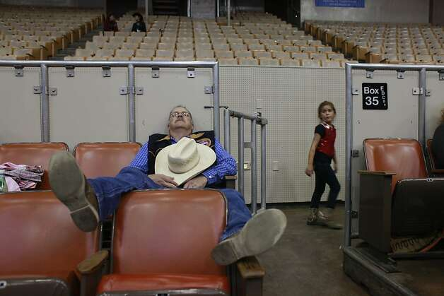Jerry Dominguez, of Castro Valley, naps between competitions at The Grand National Drill Team Jackpot. Photo: Mike Kepka, The Chronicle