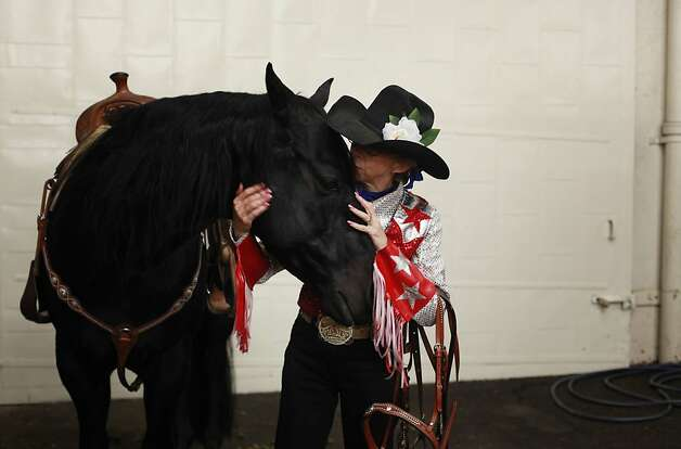 Laura Vaughn comforts her horse Pepper before a competing at The Grand National Drill Team Jackpot. Photo: Mike Kepka, The Chronicle