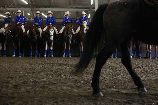 The California Cowgirls wait the finale at The Grand National Drill Team Jackpot. Photo: Mike Kepka, The Chronicle