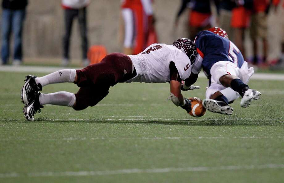 Cy-Fair's (#9) Ryan Bradshaw looses the ball to Alief Taylor's (#5) David King in the first half of the Class 5A Division I Playoff Football game at Berry Center on Friday, Nov. 16, 2012, in Houston. Photo: Mayra Beltran, Houston Chronicle / © 2012 Houston Chronicle