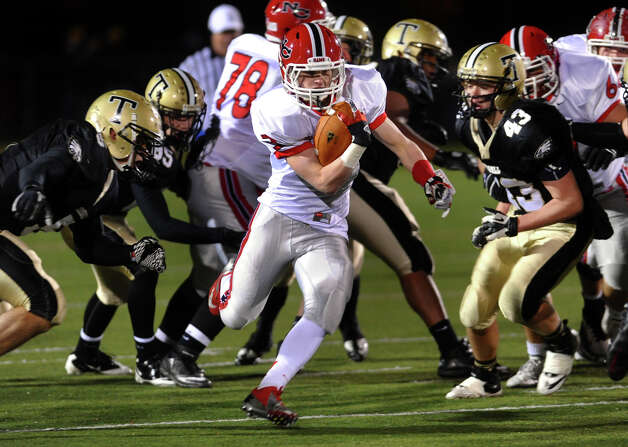 New Canaan's #3 Jack Gilio weaves his way through Trumbull defense, during boys football action in Trumbull, Conn. on Friday November 16, 2012. Photo: Christian Abraham / Connecticut Post