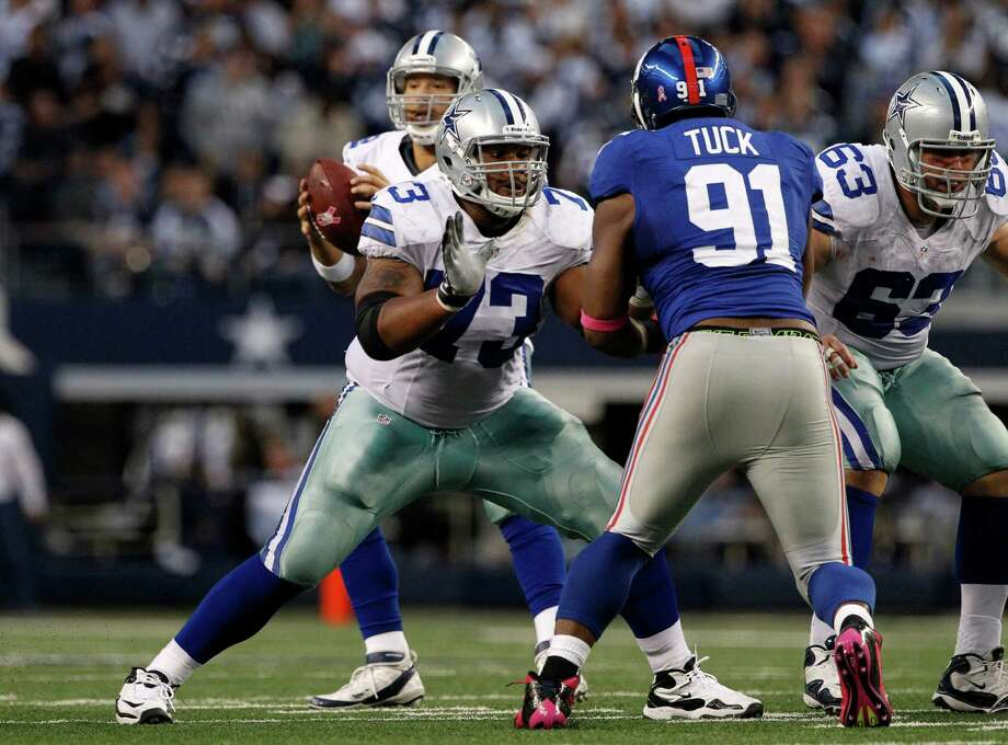 Cowboys right guard Mackenzy Bernadeau (73) will have to protect quarterback Tony Romo as well as snap the ball if center Ryan Cook (63) is unable to play. Photo: Tony Gutierrez, STF / AP