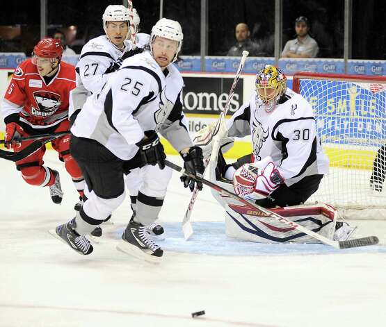 San Antonio Rampage goaltender Jacob Markstrom, right, makes a save during the first period of an AHL hockey game against the Charlotte Checkers, Friday, Nov. 16, 2012, in San Antonio. Photo: Darren Abate, Darren Abate/pressphotointl.com / Darren Abate/pressphotointl.com