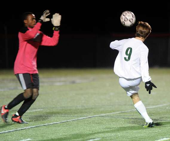 Norwalk's Kevin Joslyn kicks a goal during Friday's Class LL boys soccer semifinal game at New Canaan High School on November 16, 2012. Photo: Lindsay Niegelberg / Stamford Advocate