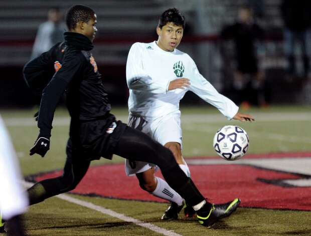 Stamford's Marc Guirand and Norwalk's Jose Canahui compete for control of the ball during Friday's Class LL boys soccer semifinal game at New Canaan High School on November 16, 2012. Photo: Lindsay Niegelberg / Stamford Advocate