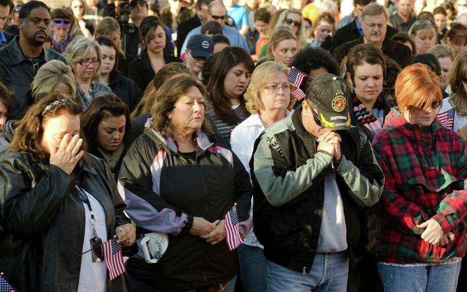 Hundreds gather early Friday, Nov. 16, 2012, in Midland, Texas, some holding flags, for a prayer service to honor and pray for all those involved in the incident on Thursday where four veterans were killed and 16 other people were injured when a train slammed into a parade float carrying the returning heroes to a banquet. Photo: Tim Fischer, Reporter-Telegram / Reporter-Telegram