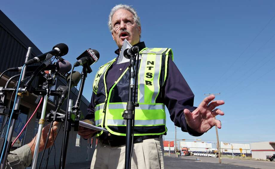 National Transportation Safety Board member Mark Rosekind speaks during a press conference at the scene of the crash, Friday Nov. 16, 2012, involving a Union Pacific train and a parade float carrying military veterans in Midland, Tx. Four veterans were killed in the accident which occurred Thursday afternoon. Photo: Edward A. Ornelas, San Antonio Express-News / © 2012 San Antonio Express-News