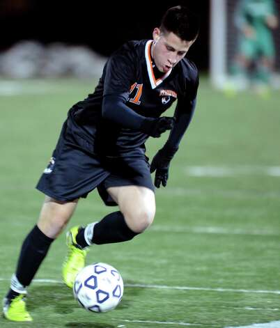 Stamford's Steven Lopez controls the ball during Friday's Class LL boys soccer semifinal game at New Canaan High School on November 16, 2012. Photo: Lindsay Niegelberg / Stamford Advocate