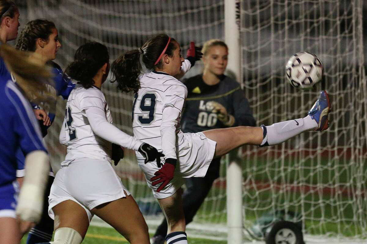 Mike Ross Connecticut Post freelance -Immaculate's #99 Hailey Davis take a shot on Old Lyme's #00 goalie Erin Kroes during Friday evenings Class S state semifinals at Strong Stadium in West Haven.