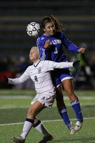 Mike Ross Connecticut Post freelance -Immaculate's #8 Rachel Raffini battles for the ball against Old Lyme's #4 Jessica Lee at Friday evenings Class S state semifinals in West Haven. Photo: Mike Ross / Connecticut Post Freelance