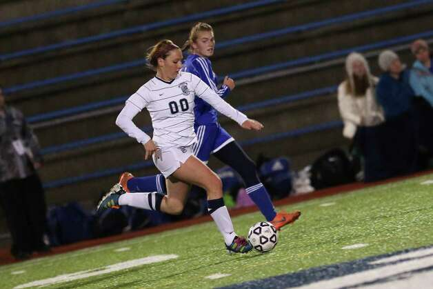 Mike Ross Connecticut Post freelance -Immaculate's #00 Sierra Stein moves the ball down field as a  Old Lyme's defender gives chase during Friday evenings Class S state semifinals in West Haven. Photo: Mike Ross / Connecticut Post Freelance