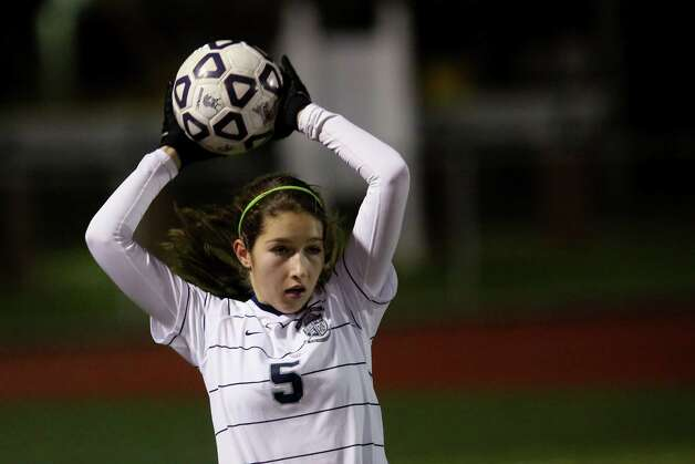Mike Ross Connecticut Post freelance -Immaculate's #5 Stephanie Pellegrino looks to throw the ball to open teammate during Friday evenings Class S state semifinals against Old Lyme. Photo: Mike Ross / Connecticut Post Freelance