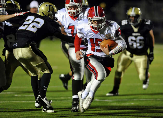 New Canaan QB Nick Cascione drives the ball to the endzone for a touchdown, during boys football action against Trumbull in Trumbull, Conn. on Friday November 16, 2012. Photo: Christian Abraham / Connecticut Post