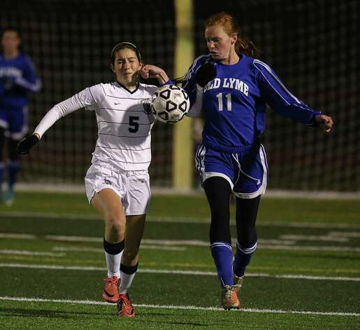 Mike Ross Connecticut Post freelance -Immaculate's #5 Stephanie Pellegrino battles for possession of the balll from Old Lyme's #11 Lexi Sibley during Friday evening Class S state semifinals held at Strong Stadium in West Haven. Photo: Mike Ross / Connecticut Post Freelance