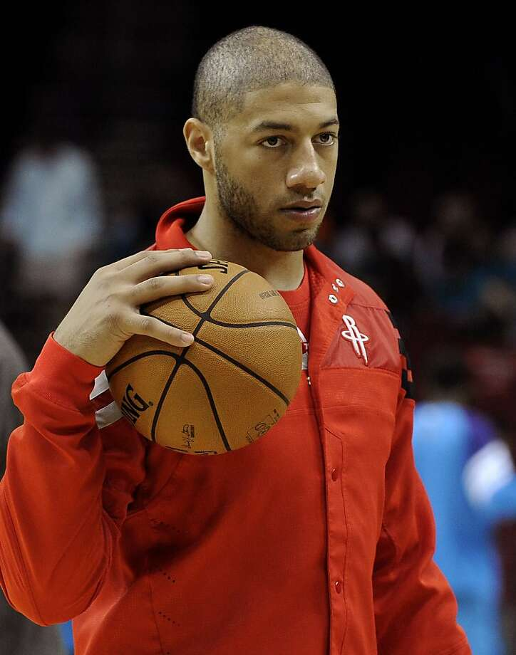 FILE - This Oct. 12, 2012 file photo shows Houston Rockets' Royce White before a preseason NBA basketball game against the New Orleans Hornets in Houston. White remains absent from the team in a dispute over how the Rockets are helping him confront his anxiety disorder. White, who's yet to play in a game, did not attend Monday's game against Miami, Tuesday's practice or the shootaround in advance of Wednesday night's, Nov. 14, 2012 game with New Orleans. (AP Photo/Pat Sullivan, File) Photo: Pat Sullivan, Associated Press