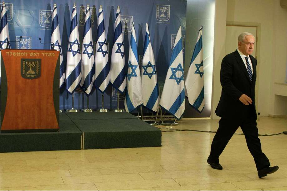 FILE - In this Thursday, Nov. 15, 2012 file photo, Israeli prime minister Benjamin Netanyahu leaves the room after delivering a statement to the media in Tel Aviv, Israel.  The freewheeling seaside oasis of Tel Aviv has long served as an escape from the troubles of everyday Israel. Thanks partly to its vibrant nightlife and balmy climate, it's also developed an international reputation as a fun place to visit _ and one of the few places in the Middle East where gays feel free to walk hand-in-hand and kiss in public. Now, for the first time ever, Israel's financial and cultural capital is also the target of Iranian-made rockets fired by Hamas militants in the Gaza Strip.(AP Photo/Dan Balilty, File) Photo: Dan Balilty