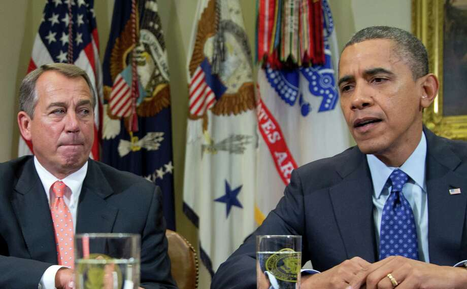 President Barack Obama, accompanied by House Speaker John Boehner of Ohio, speaks to reporters in the Roosevelt Room of the White House in Washington, Friday, Nov. 16, 2012, as he hosted a meeting of the bipartisan, bicameral leadership of Congress to discuss the deficit and economy in Washington.  (AP Photo/Carolyn Kaster) Photo: Carolyn Kaster