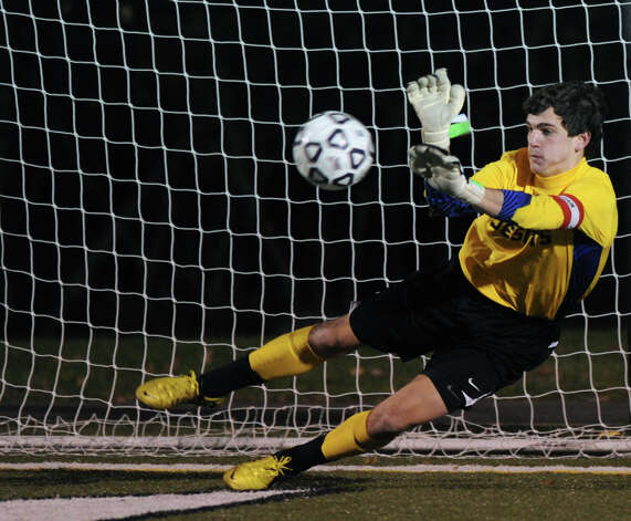Fairfield Prep's William Steiner blocks a shot by Greenwich's Aidan Rafferty during a shootout in Friday's Class LL boys soccer semifinal game at New Canaan High School on November 16, 2012. Photo: Lindsay Niegelberg / Stamford Advocate