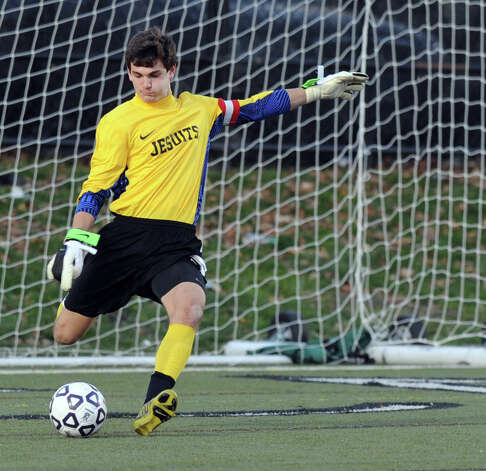 Fairfield Prep's William Steiner makes a save during Friday's Class LL boys soccer semifinal game at New Canaan High School on November 16, 2012. Photo: Lindsay Niegelberg / Stamford Advocate