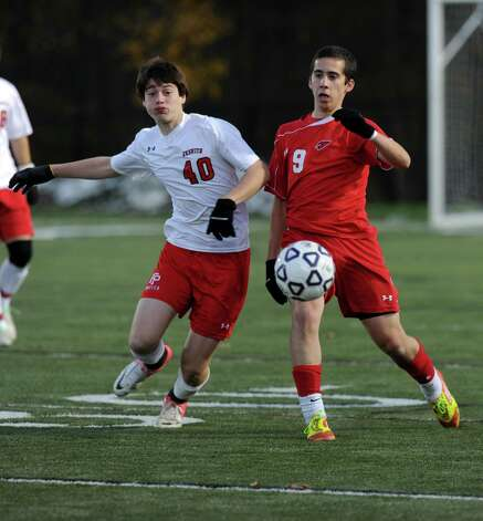 Fairfield Prep's Chris Molina and Greenwich's Julio Arnao compete for control of the ball during Friday's Class LL boys soccer semifinal game at New Canaan High School on November 16, 2012. Photo: Lindsay Niegelberg / Stamford Advocate