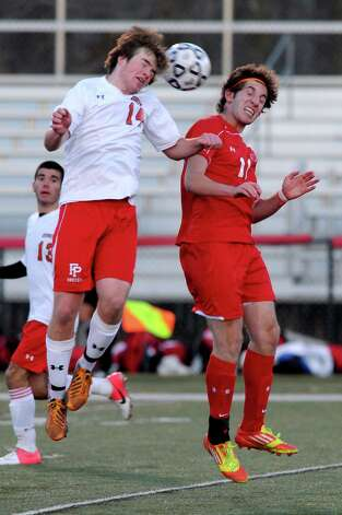 Fairfield Prep's Darragh Kelly and Greenwich's Aidan Rafferty jump to head the ball during Friday's Class LL boys soccer semifinal game at New Canaan High School on November 16, 2012. Photo: Lindsay Niegelberg / Stamford Advocate