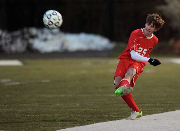 Greenwich's Jamie Kyle controls the ball during Friday's Class LL boys soccer semifinal game at New Canaan High School on November 16, 2012. Photo: Lindsay Niegelberg / Stamford Advocate