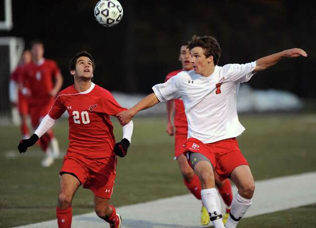 Greenwich's Mateo Gowland and Fairfield Prep's Timothy Frassetto compete for control of the ball during Friday's Class LL boys soccer semifinal game at New Canaan High School on November 16, 2012. Photo: Lindsay Niegelberg / Stamford Advocate