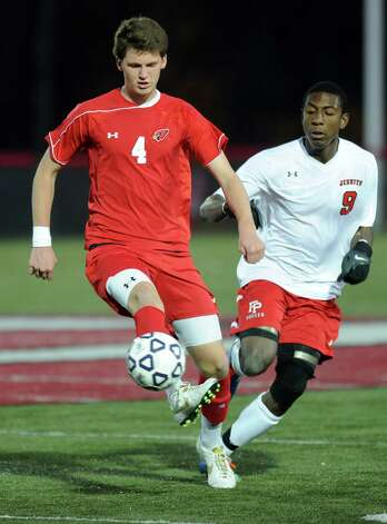Greenwich's Will Gittings controls the ball during Friday's Class LL boys soccer semifinal game at New Canaan High School on November 16, 2012. Photo: Lindsay Niegelberg / Stamford Advocate